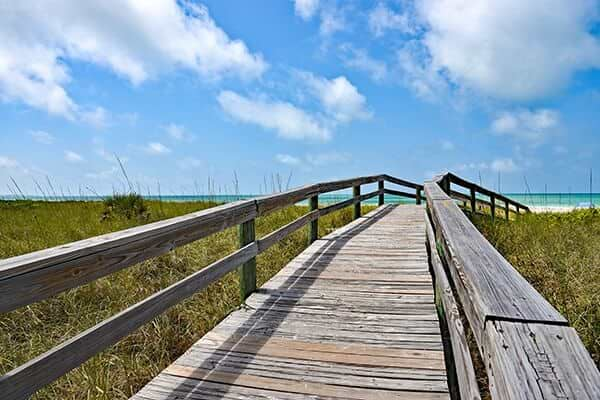 Wooden Beach Boardwalk leading to the white sandy Anna Maria Island, Florida