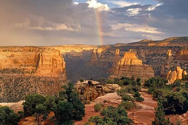 canyon view of rainbow on a sun setting evening
