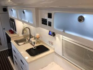 Kitchen Galley with Upper Frosted Cabinets