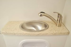 Bathroom, Shower, Vanity with Fiber-Granite Countertop and Sink